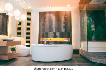 Beautiful luxury vintage empty bathtub  Freestanding white bath. bathroom is beautifully decorated with wooden tiles and electric lamps.