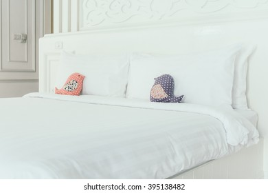 Beautiful luxury white pillow on bed decoration in bedroom interior - Vintage Light Filter