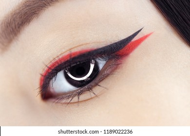 Beautiful macro shot of female eye with creative asian makeup. Perfect skin. Cosmetics and make-up concept. Closeup macro shot of fashion eyes visage