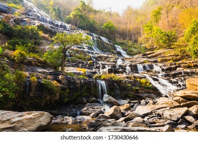 Beautiful Mae Ya Waterfall in autumn forest at Doi Inthanon National Park, Chiangmai, Thailand