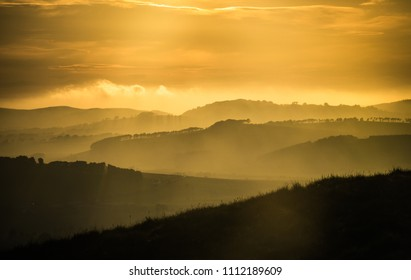 Beautiful Magic Hour Light Over Misty Rolling Hills