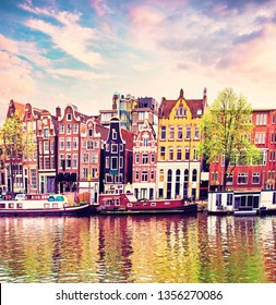 Beautiful magic spring landscape with flowers and old Dutch buildings  in Amsterdam, Holland. amazing places. popular tourist atraction