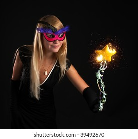 beautiful magician with Magic wand