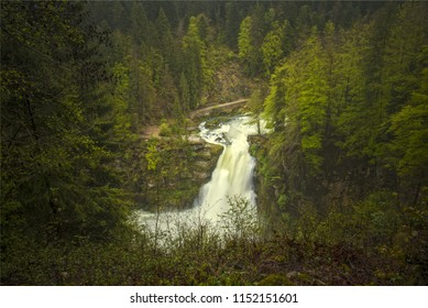 Beautiful and magnificent big waterfall into the fresh and green forest in doubs france