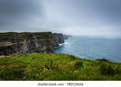 beautiful and majestic cliff of Moher in Ireland. The Cliffs of Moher are located at the southwestern edge of the Burren region in County Clare, Ireland. The Cliffs of Moher are 702 feet long.