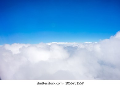 Beautiful Majestic clouds on a blue sky viewed from a aeroplane, Spain, Europe