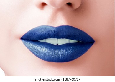 Beautiful make up of glamour blue lips, lipstick on the face of an attractive beautiful woman as a beauty and health concept pertaining to cosmetics and female business fashion