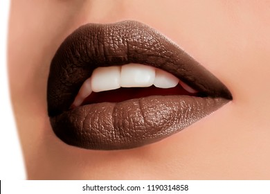 Beautiful make up of glamour brown lips, lipstick on the face of an attractive beautiful woman as a beauty and health concept pertaining to cosmetics and female business fashion
