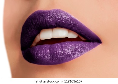 Beautiful make up of glamour purple lips, lipstick on the face of an attractive beautiful woman as a beauty and health concept pertaining to cosmetics and female business fashion
