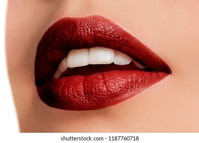 Beautiful make up of glamour wine red lips, lipstick on the face of an attractive beautiful woman as a beauty and health concept pertaining to cosmetics and female business fashion