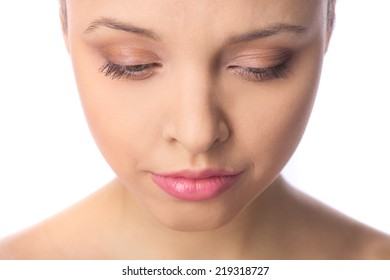 Beautiful makeup woman face looking down. portrait of beautiful natural woman on white background looking down