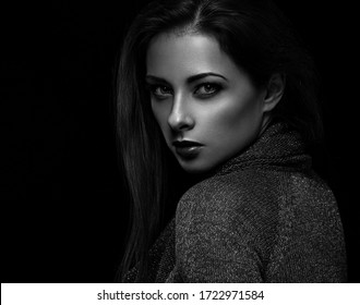 Beautiful makeup woman with long hair looking sexy on black background in darkness. Closeup portrait. Art.Expression portrait. Vogue. Black and white