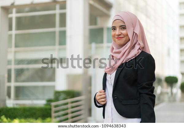 Beautiful Malay girl outdoor wearing executive suit