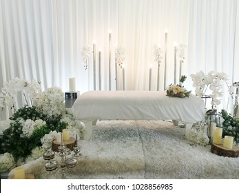 Beautiful Malay wedding dais with fresh flowers decoration in white theme background