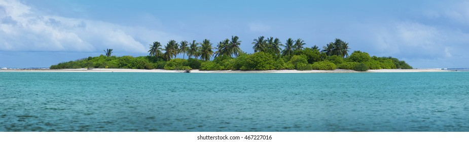 Beautiful Maldivian atoll with white beach seen from the sea.Panorama