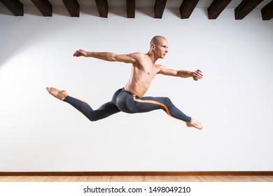 Beautiful male ballett dancer performing indoor