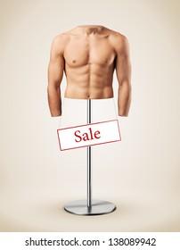 Beautiful male torso like a manikin. Muscular man. Gym
