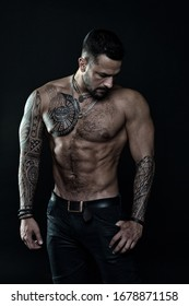 Beautiful male torso. Men tattoo casual fashion. muscular bodybuilder posing. sexy portrait of sport man. Tattooed muscular guy posing in studio. Workout for good health. Prank to abdominal muscles.