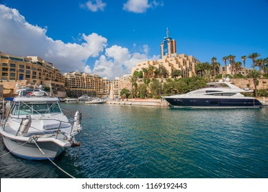 Beautiful MALTA - ST. JULIAN'S . Sunny view of beautiful yachts .