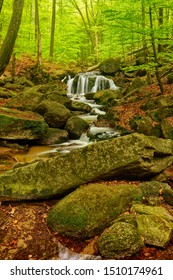 Beautiful Maly waterfall in super green spring forest surroundings, Czech Republic
