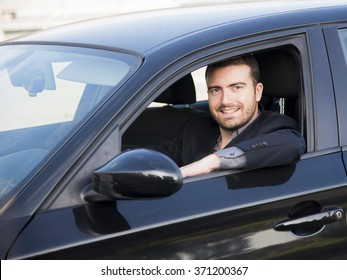 Beautiful man driving very happy his car