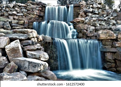 Beautiful man made waterfall surrounded by small boulders in Wichita Falls Texas