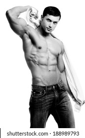 Beautiful man with muscular body holding the towel in black and white