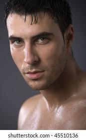 Beautiful man on gray background