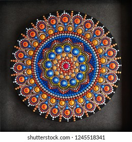 Beautiful mandala painted isolated on gray