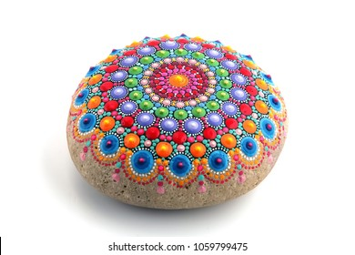 Beautiful mandala painted on a stone, isolated on white background
