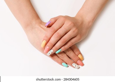 beautiful manicure, nail polish of different colors on the female nails