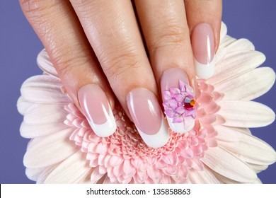 Beautiful manicure with pink flower design