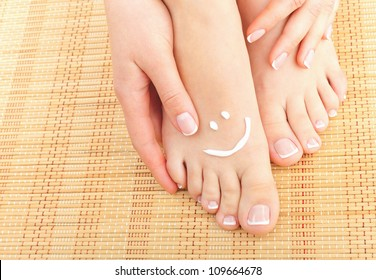 Beautiful manicured feet with pedicures. Close-up