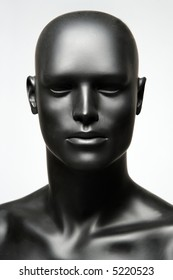 beautiful mannequin standing alone on the light background