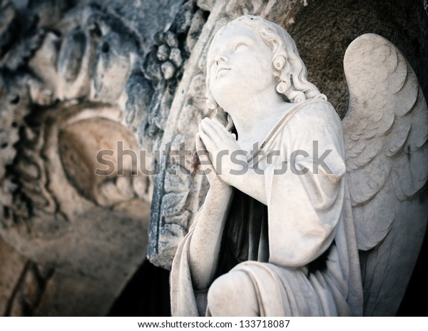 Beautiful marble angel praying