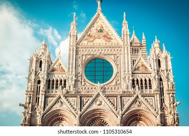 Beautiful marble facade of old landmark of Siena Cathedral (Duomo di Siena catholic church) in Siena, Tuscany, Italy.