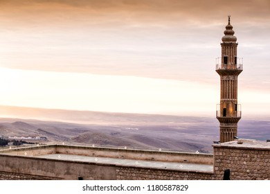 Beautiful Mardin old city landscape from Minaret of the Great Mosque. It known also as Ulu Cami. Old minaret with mesopotamian plain in the background in Turkey