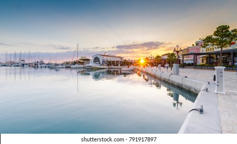 Beautiful Marina, Limassol city Cyprus. Modern, high end life in newly developed port with docked yachts, restaurants, shops, a landmark for waterfront promenade. View of the commercial area at sunset