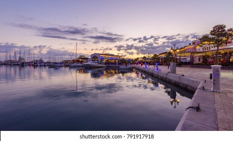 Beautiful Marina,Limassol city Cyprus at dusk. Modern, high end life, newly developed port, docked yachts, restaurants, shops, a landmark for waterfront promenade.View of the commercial area at sunset