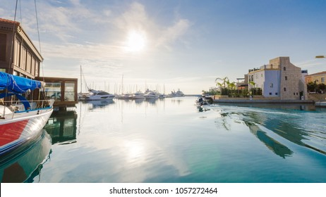Beautiful Marina,Limassol city Cyprus. Modern, high end life in newly developed port with docked yachts, restaurants, shops, a landmark for waterfront promenade.View of the residential area at sunrise