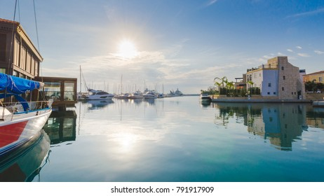 Beautiful Marina,Limassol city Cyprus. Modern, high end life in newly developed port with docked yachts, restaurants, shops, a landmark for waterfront promenade.View of the residential area at sunset.