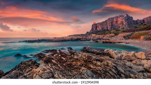 Beautiful marine scenery. Great spring sunset on Sicily, Isolidda Beach, San Vito cape, Italy, Europe. Dramatic evening seascape of Mediterranean sea. Beauty of nature concept background.