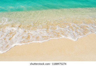 Beautiful marine view on caribbean sea coast line with clean wavy surf ocean water on sandy beach in st. john, Antigua at sunny day as natural background