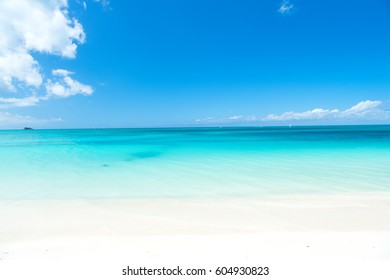 Beautiful marine view on caribbean sea coast line with clean wavy surf ocean water on sandy beach at sunny day as natural background with blue sky, st. john, Antigua
