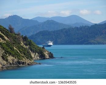 Beautiful Marlborough Sounds South Island New Zealand showing hills and passenger ferry.
