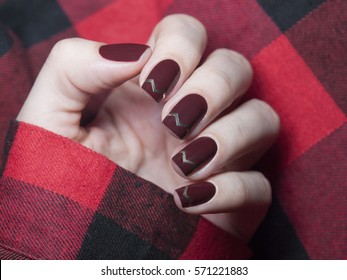 Beautiful maroon nails with chevron design.