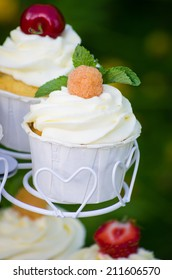 Beautiful mascarpone cupcake with a yellow raspberry on top