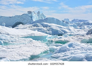 beautiful massive icebergs in the Disko bay Greenland - Icefjord Ilulissat - Baffin bay - turquoise water in the ice sea