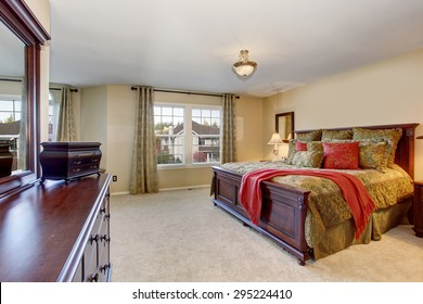 Beautiful master bedroom with carpet, including large vanity with drawers.