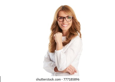A beautiful mature happy woman smiling confidently while standing at isolated white background with copy space.